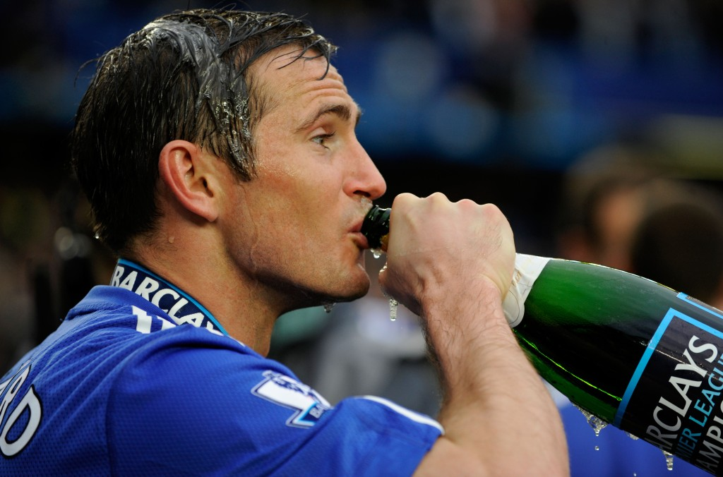 Frank Lampard of Chelsea celebrates his teams title with a drink of champagne